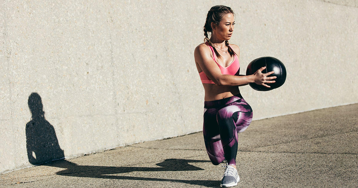 The Total Body Medicine Ball Workout That Carves Your Core Shape