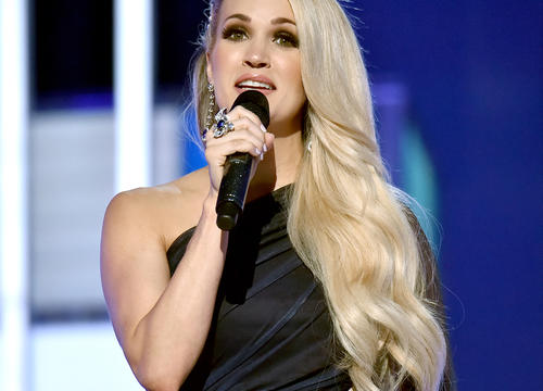 "Carrie Underwood Reveals the One Thing That Gives Her a ""Little Boost"" at the Gym"