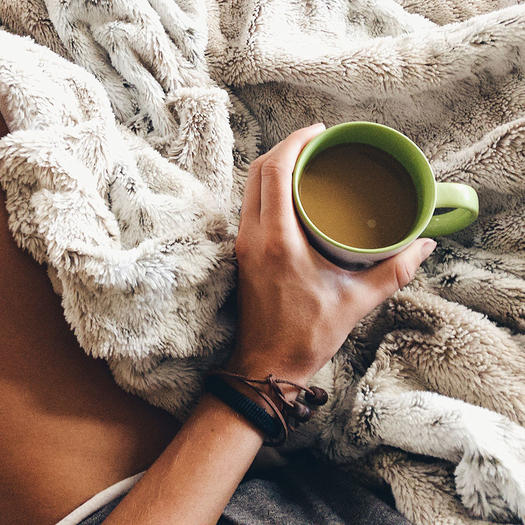 woman drinking coffee with weighted blanket