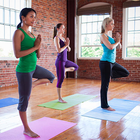 women doing yoga exercising for good gut health