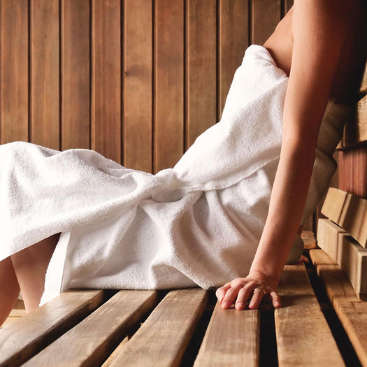 woman using a sauna as a healthy lifestyle habit