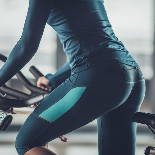 Woman Cycling In Workout Underwear And Leggings