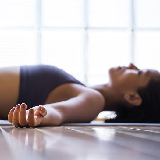 woman doing yoga savasana for weight loss motivation