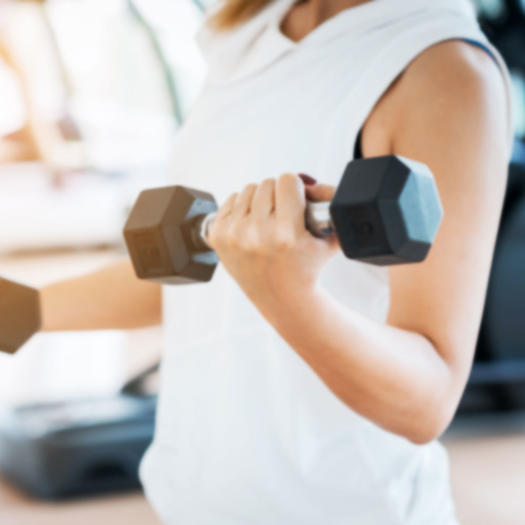 woman lifting weights as a healthy lifestyle habit