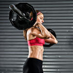 woman lifting weights to burn body fat
