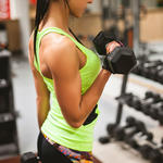 woman lifting weights for muscle definition and toning