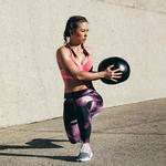 woman doing medicine ball workout
