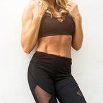woman with abs modeling for standing abs workout