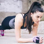 woman doing planks abs exercise daily as a healthy lifestyle habit