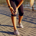 woman strength training with knee injury