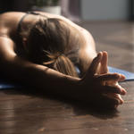 woman doing restorative yoga winter date idea