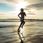 woman running on beach for benefits of running