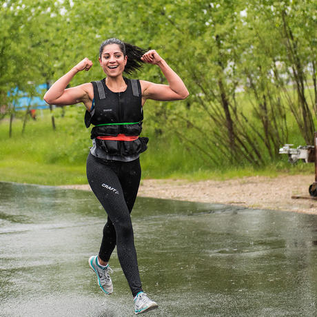 woman running in a weighted vest